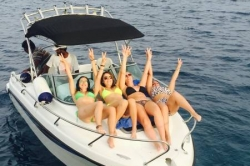 Girls enjoying speedboat ride